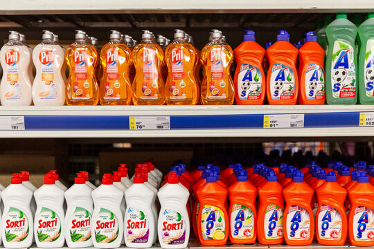 Rows of bottles of home cleaning products on store shelves. Front view. Moscow, Russia, 11-25-2020.