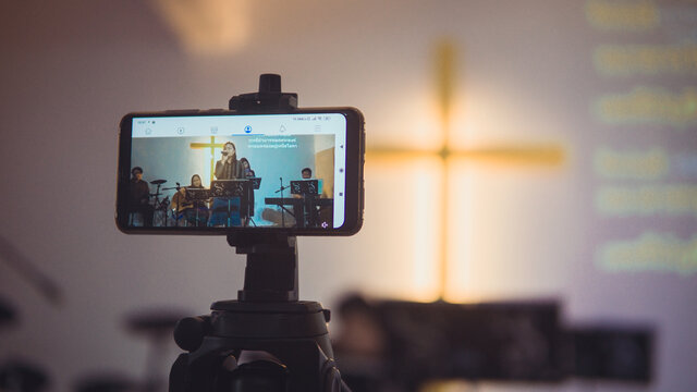 Church services online with new normal concept, Live worship with smartphone.