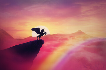 Wild pegasus silhouette on a cliff edge against a pink paradise sunset. Magical background, surreal creature as unicorn with wings, over the rainbow. Freedom and adventure concept, secret dreamland