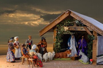Christmas Crib in Alsace, France - An ancient tradition for which each family installs a table with a crib near the fireplace. The characters: shepherds, fishmongers, bakers are made with great care.