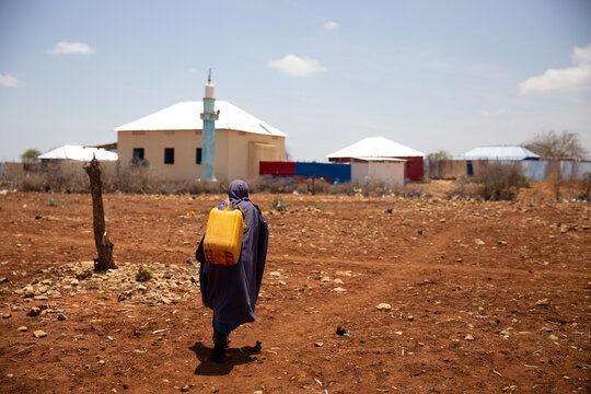 Kids walking home after water distribution during deadly drought in Somalia