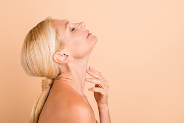 Profile photo of natural beauty concept aged lady naked shoulders soft neck skin isolated pastel beige color background