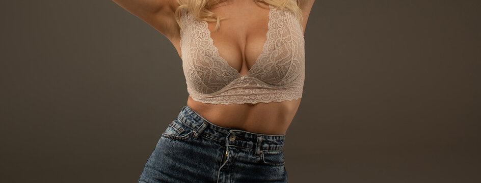 Women body. Bra model. Plastic surgery. Female breast. Women body shape. Breast boobs, woman after plastic surgery. Close up of breast of attractive girl presenting her bra. Woman in underwear.