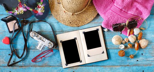 enjoying photography during summer holidays, camera, photo album with empty frames and vacation items,flat lay