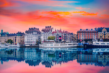 Strandvagen boulevard with boats and historic buildings at colorful sunset in stockholm sweden