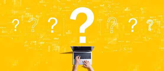 Question marks with person working with a laptop