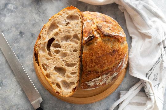 Sourdough bread slices, on a cutting board. Organic homemade bread.