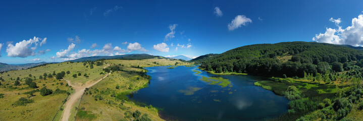 Fototapeta default 180 degree virtual reality panorama of Biviere lake immersed in the beautiful beech forest of Monte Soro in spring on the Nebrodi, Sicily, Italy. Natural lake with views of Mount Etna and sea.