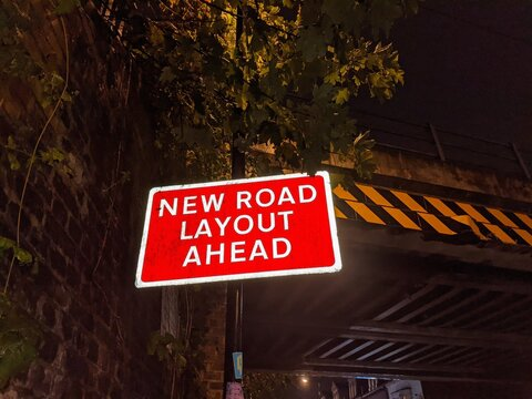 UK road sign reading 'new road layout ahead.'