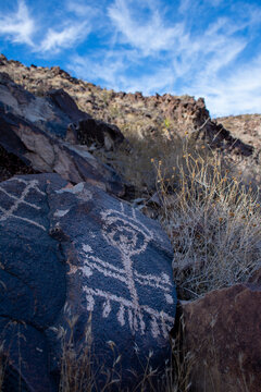Stone drawings called petroglyphs created by native indigenous people appear on boulders near Las Vegas, Nevada