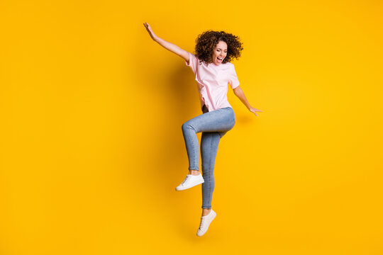 Photo portrait full body view of happy girl dancing jumping up isolated on vivid yellow colored background