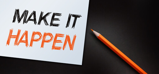 Make It Happen written with orange pencil. Used in business, life and sports coaching well known phrase for getting things done