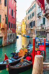 VENICE, ITALY- December 21, 2017 : Tourists on Water street with Gondola in Venice, ITALY
