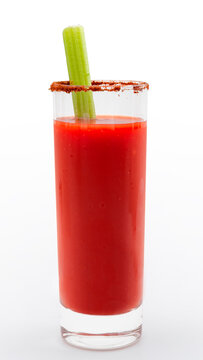 Classic brunch drink, hangover remedy and vodka based mixed drinks concept with bloody Mary cocktail in tall cylindrical glass and a celery stick isolated on white background with clipping path cutout