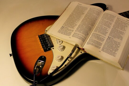 guitar plugged into Holy Bible for true worship