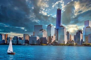 Fototapeta New York City skyline with. dramatic sky, USA