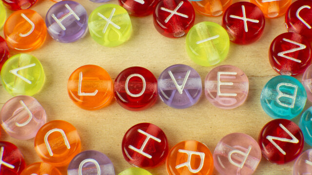 The love word on alphabet bead multi color for background content