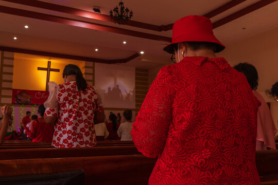 People go to church for Sunday prayers.people pray in the church.people wearing masks, praying, and standing apart,newnormal,socialdistancing,Coronavirus outbreak and coronaviruses influenza.