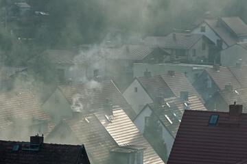 Fototapeta Smog nad domami