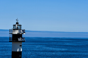 lighthouse at sea, photo as a background , in north spain, galicia, spain, europe