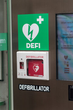 Vienna, Austria - August 30, 2020: Automated External Defibrillator (AED) in white box on the wall.