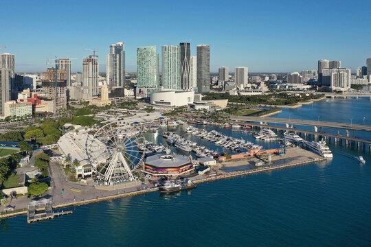 Miami, Florida - December 27, 2020 - Aerial view of Bayside Marketplace, City of Miami Marina and Miami skyline on sunny winter morning.