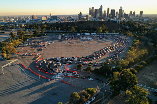 The Los Angeles skyline is seen as people line up in their vehicles at Dodger Stadium as post-Christmas COVID-19 testing resumes during a surge in positive coronavirus disease cases in Los Angeles