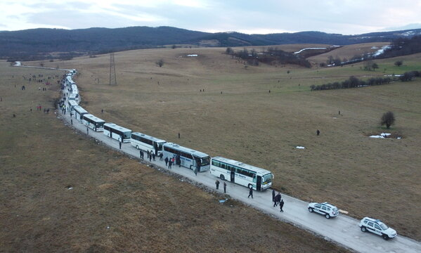 """Hundreds of migrants wait in busses after camp """"Lipa"""" was closed, in Bihac"""