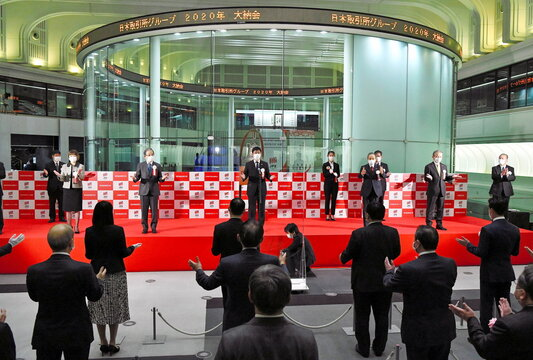 Officials practice social distancing as they attend a ceremony marking the end of trading in 2020 at the Tokyo Stock Exchange, amid the coronavirus disease (COVID-19) outbreak, in Tokyo