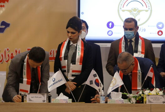 Iraq's director general at the General Company for Ports, Farhan al-Fartousi, signs a contract with South Korea's Daewoo Engineering & Construction, to construct the Grand Faw port, in Baghdad