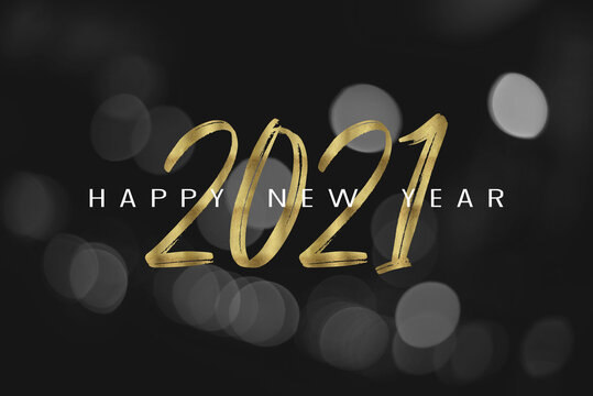 Text Happy New Year 2021 with black and white bokeh background