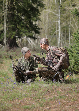 father and son bow hunting together
