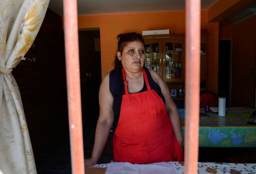 Rosalia Reyes who was sentenced to eight years in prison after her baby died during a home childbirth, works at her sister's house where she is serving a year of her time under house arrest, in Bahia Blanca