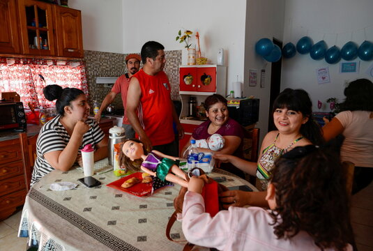 Rosalia Reyes, who was sentenced to eight years in prison after her baby died during a home childbirth, sits with her family, after she was transferred home where she will serve the rest of her time under house arrest, in Zarate