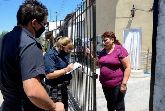 Rosalia Reyes, who was sentenced to eight years in prison after her baby died during a home childbirth, talks to the police after she was transferred home and where she will serve the rest of her time under house arrest, in Zarate