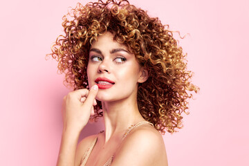 dreamy woman with curly hair looking to the side