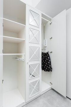 White almost empty wardrobe as a part of a modern interior.