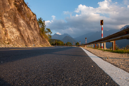 Asphalt highway winding its way through the mountains of  Hoang Lien National Park near Sapa in northern Vietnam
