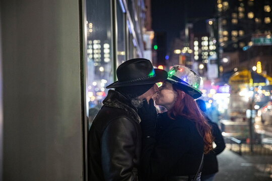 A couple kisses near Times Square during the virtual New Year's Eve event following the outbreak of the coronavirus disease (COVID-19) in the Manhattan borough of New York City