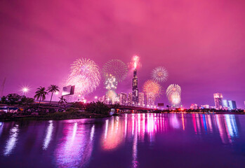 High resolution image of colorful fireworks of Ho Chi Minh City at new year 2021 view from Landmark 81 riverside.