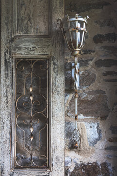 Old style lantern on a corroded wall