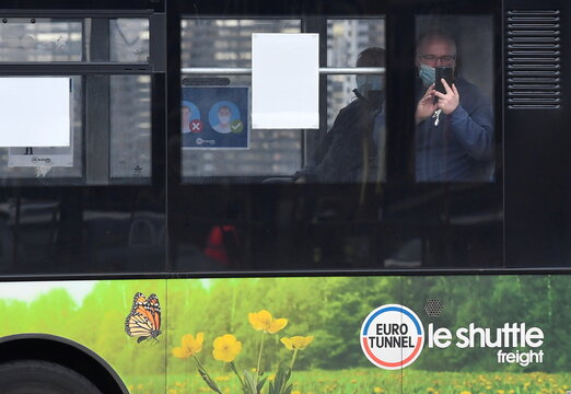 A lorry driver looks out from an internal shuttle bus as he arrives at the Eurotunnel on route to France on the first day after the end of the Brexit transition period, Folkestone, Britain