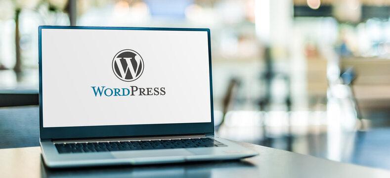 Laptop computer displaying logo of WordPress