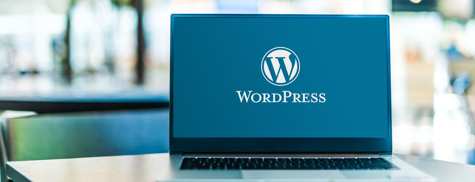 Laptop computer displaying logo of WordPress