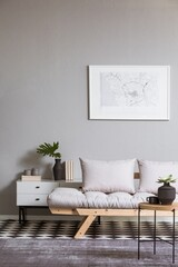 White map on grey wall in fashionable living room interior with scandinavian futon