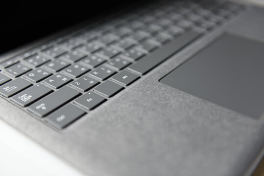 Close-up top view of laptop in platinum silver color on white background