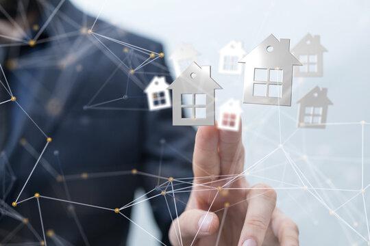 Hands - Holding House digital concept.