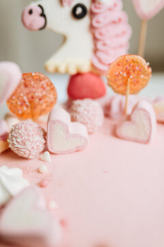 Pink cake with many decorations. Cake decorated with Marshmello