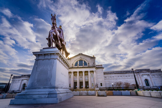 Saint Louis, MO--Dec 26, 2020; Bronze statue of King Louis IX on Horse in plaza stands in front of St. Louis Art Museum (SLAM) with clouds in background