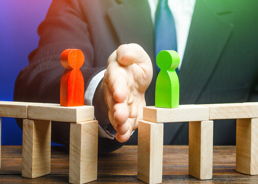 The man separates the disputes with his palm. Mediation and arbitration services. Ending an acute conflict and creating an alternative way to resolve dispute. Finding a compromise. Reducing tension